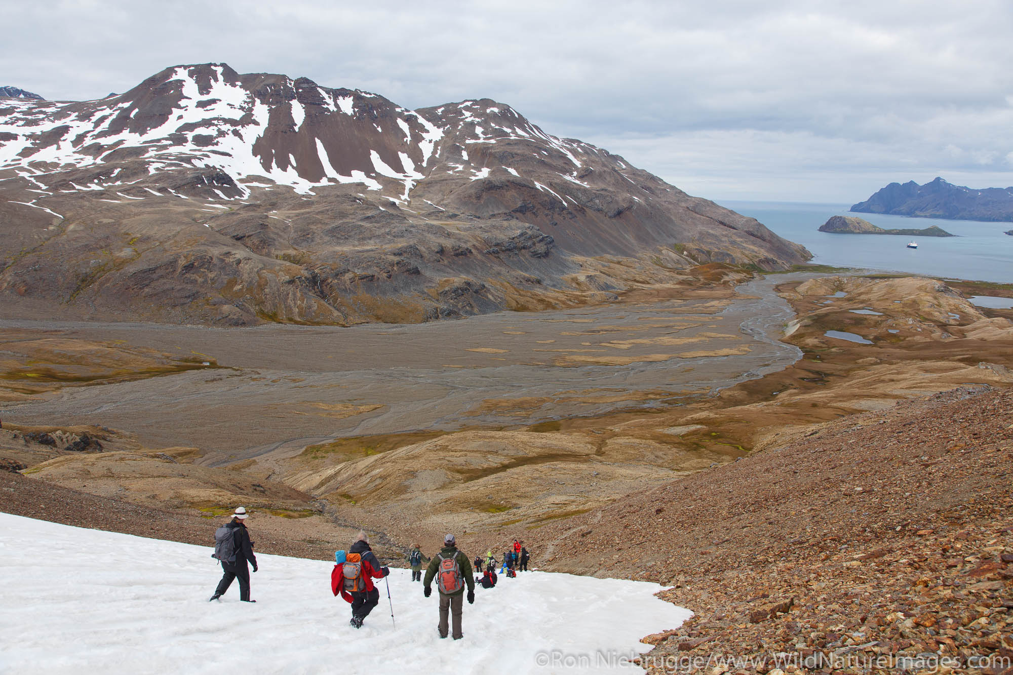 Visitors on the hike between Fortuna Bay and Stromness, the last portion of Shackleton's famous hike, South Georgia Island, Antarctica...