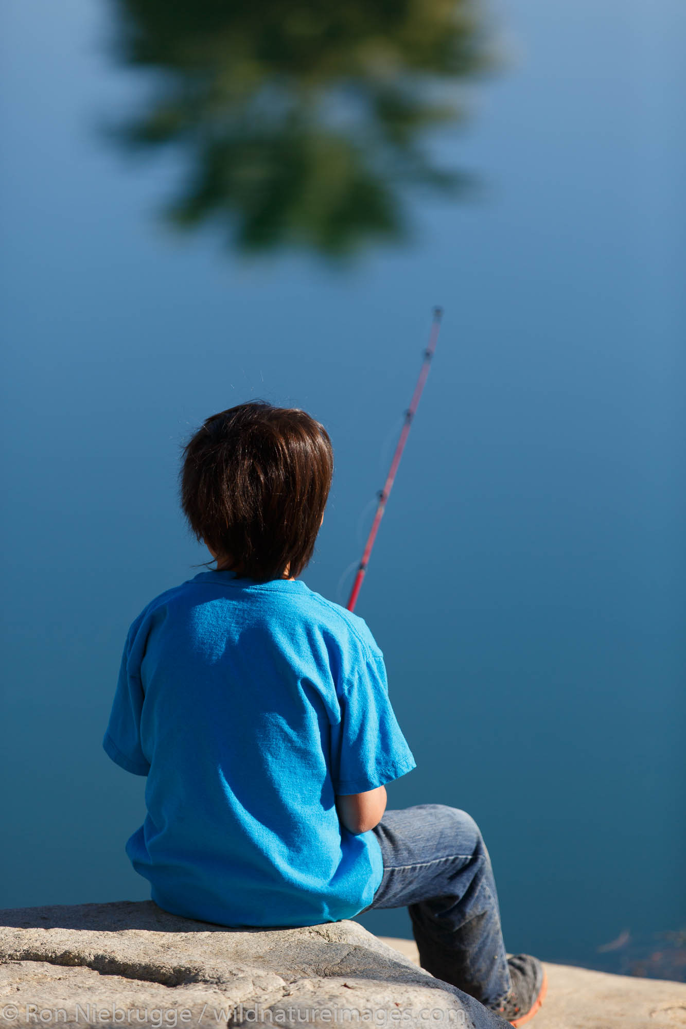 Fishing at the Springs of Borrego, Borrego Springs, California. (model released)
