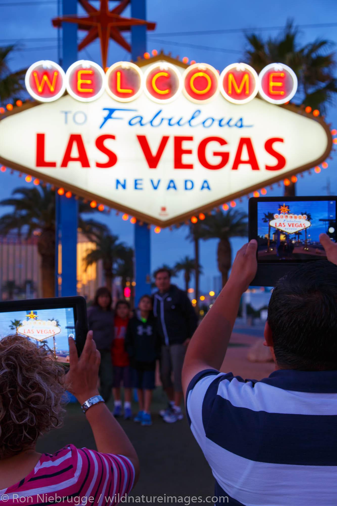 Tourists at Welcome to Las Vegas sign, Las Vegas, Nevada.