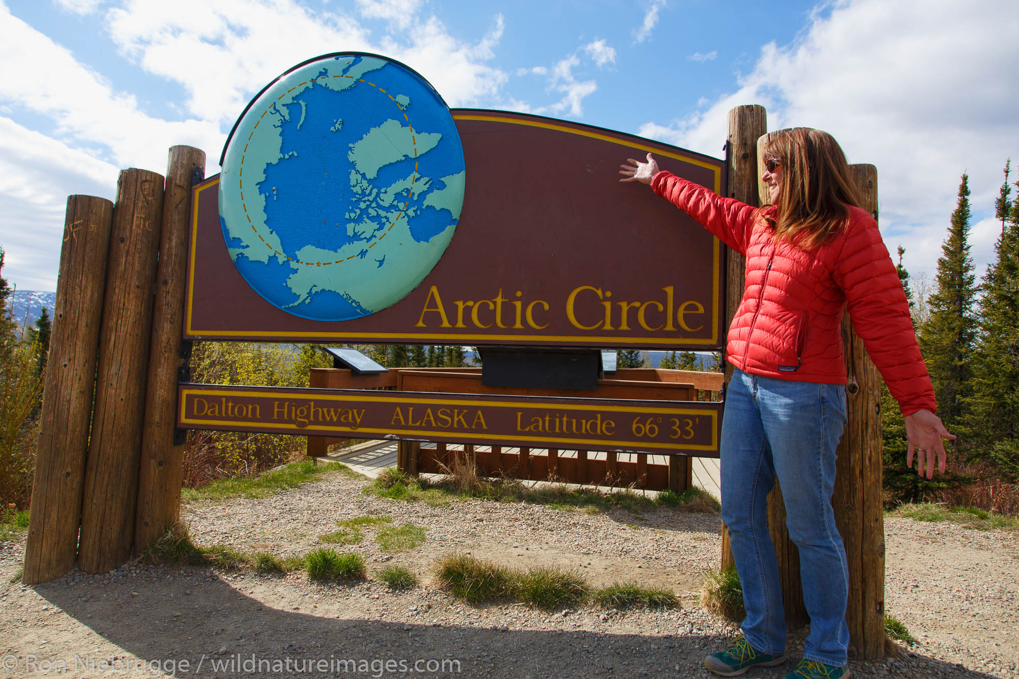Visitors at the Arctic Circle along the Dalton Highway, Alaska. (model released)