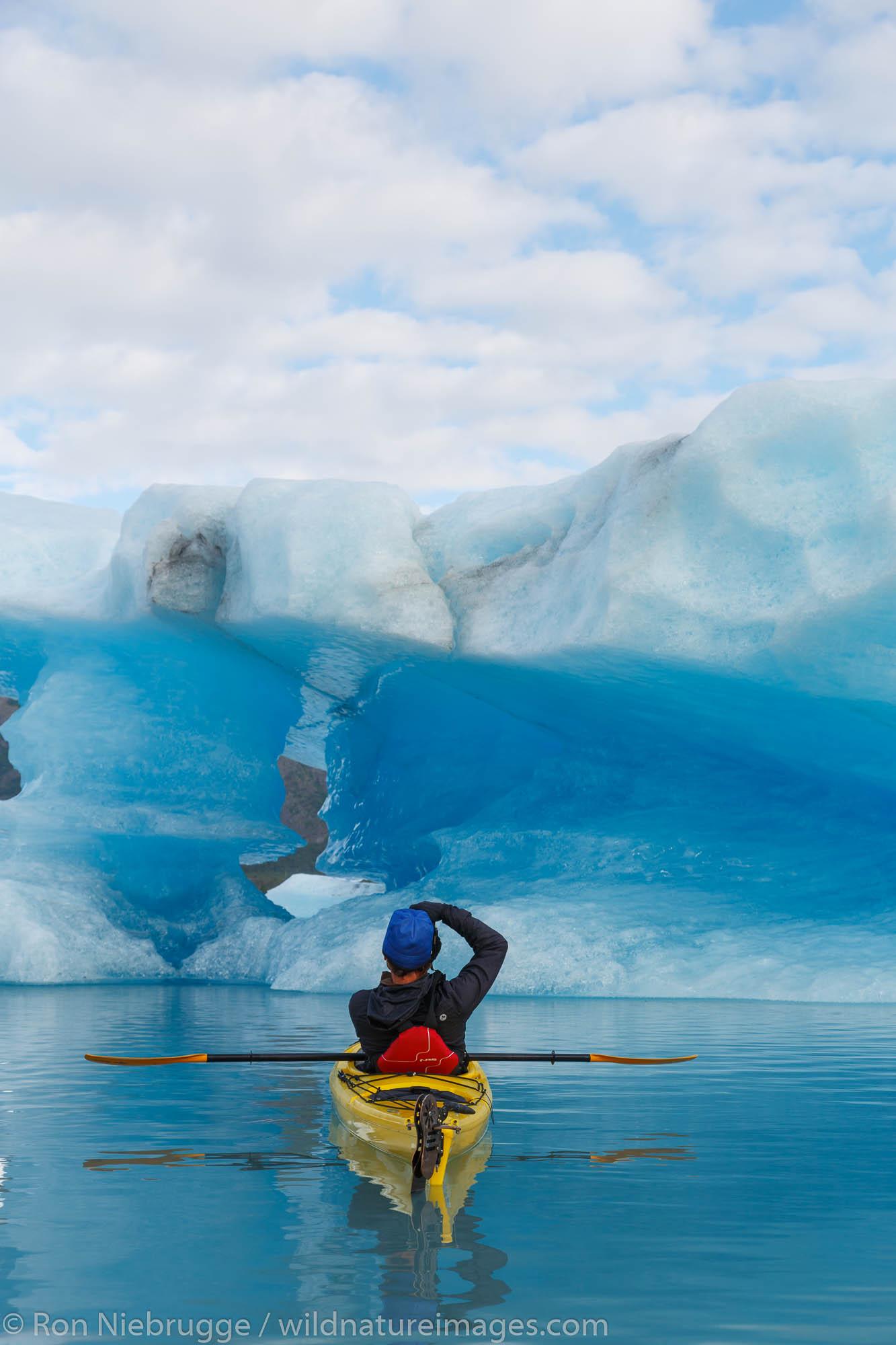 Kayaking in Bear Glacier Lagoon, Kenai Fjords National Park, near Seward, Alaska.  (model released)