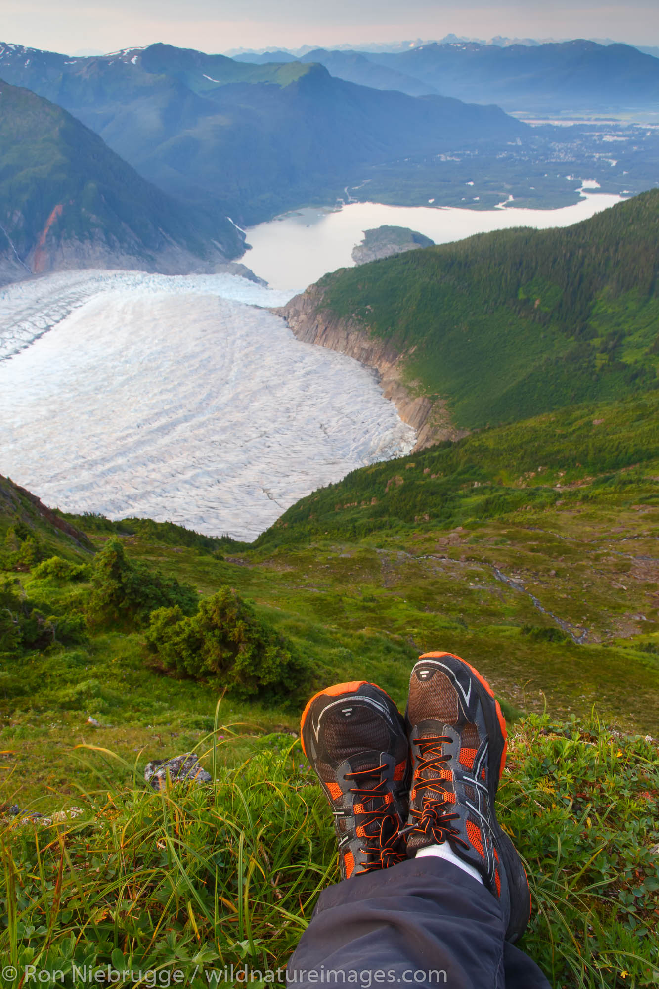 A hiker on Mount Stroller White above the Mendenhall Glacier, Tongass National Forest, Alaska.