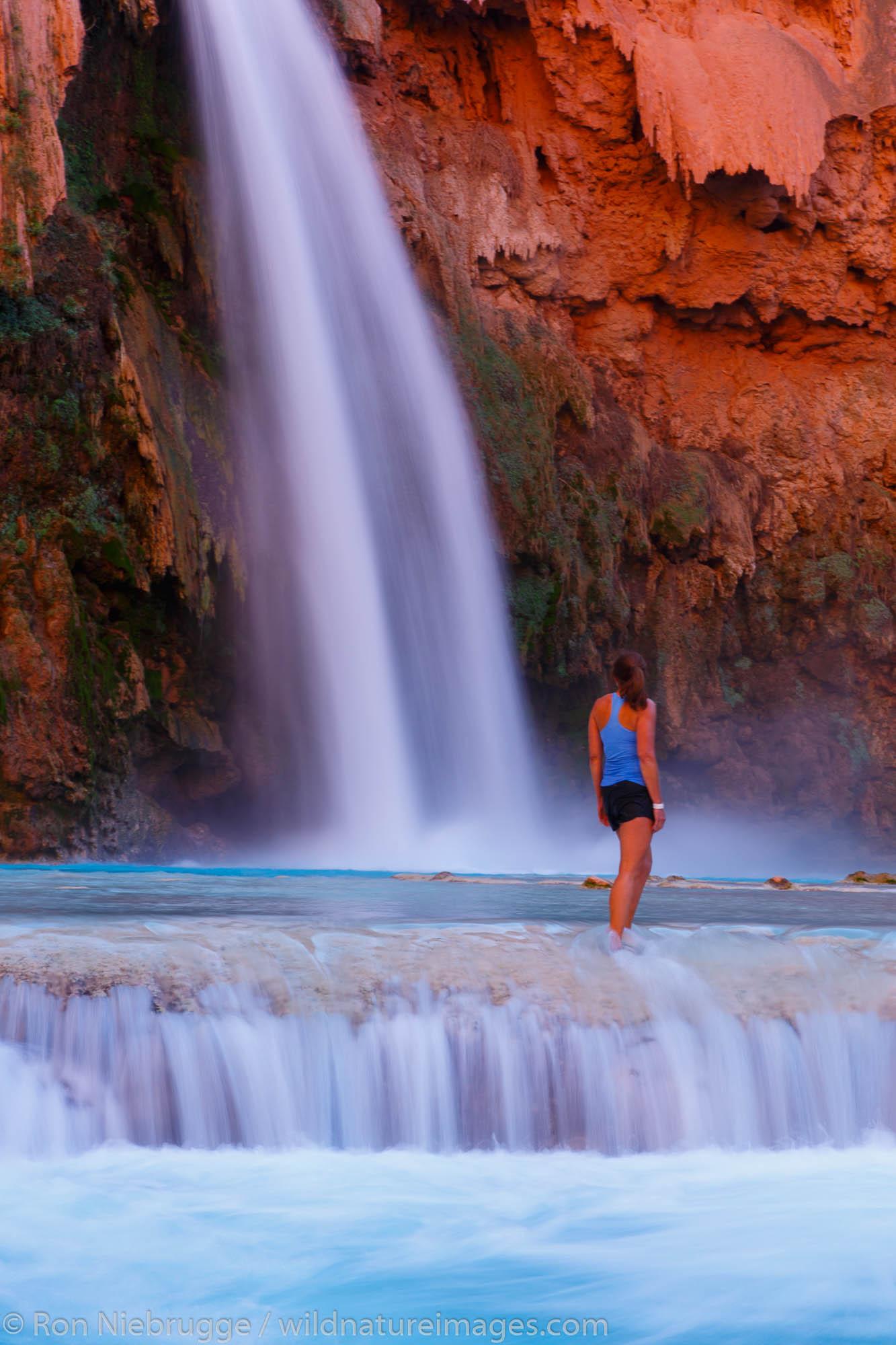 A visitor at Havasu Falls, Havasupai Indian Reservation, Grand Canyon, Arizona.  (model released)