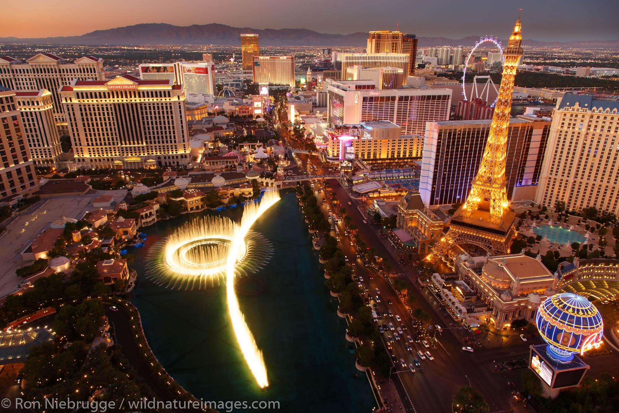 Bellagio Fountain Show and Las Vegas Strip at night, Las Vegas, Nevada.