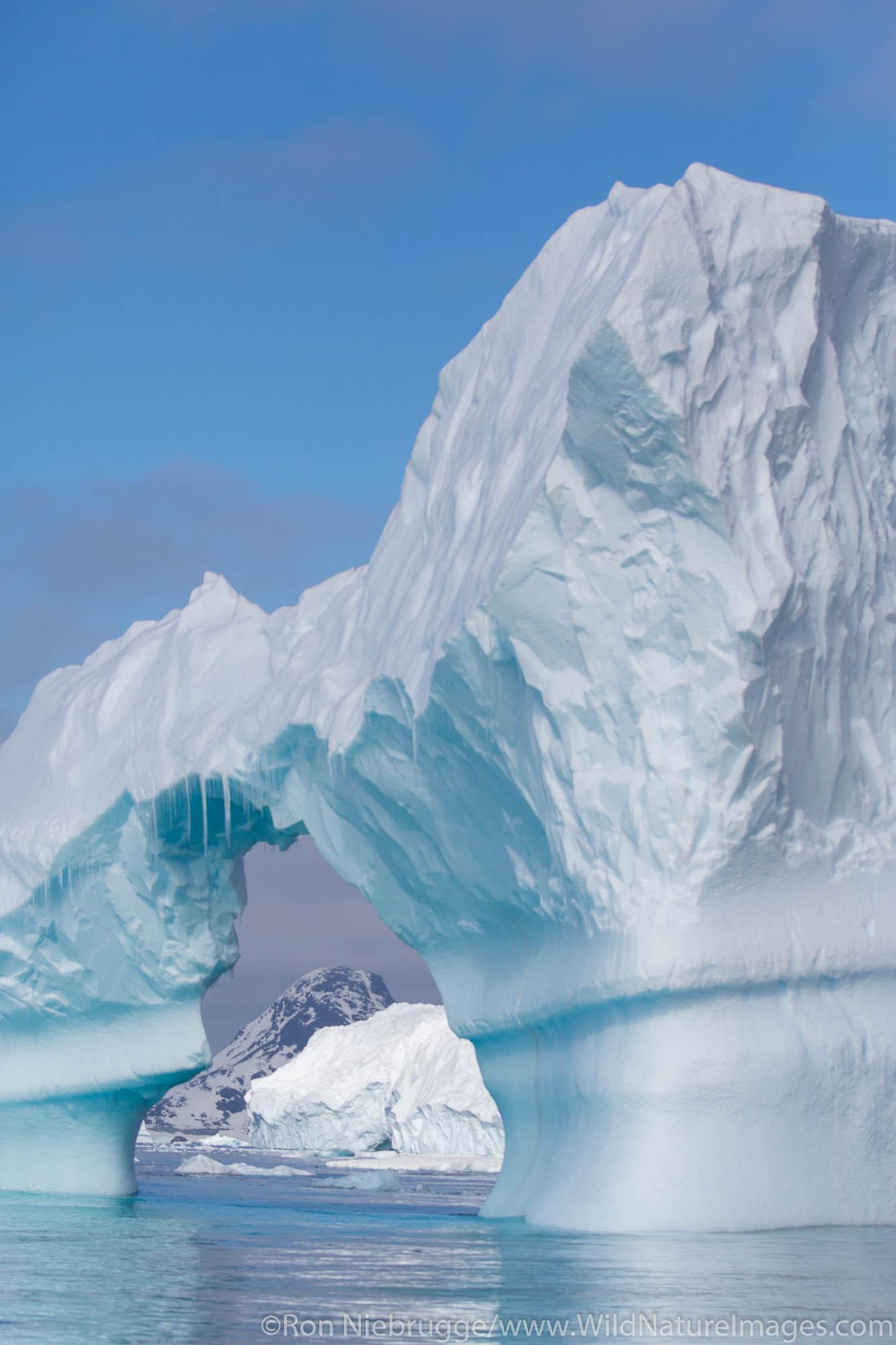 Iceberg with arch, Antarctica.