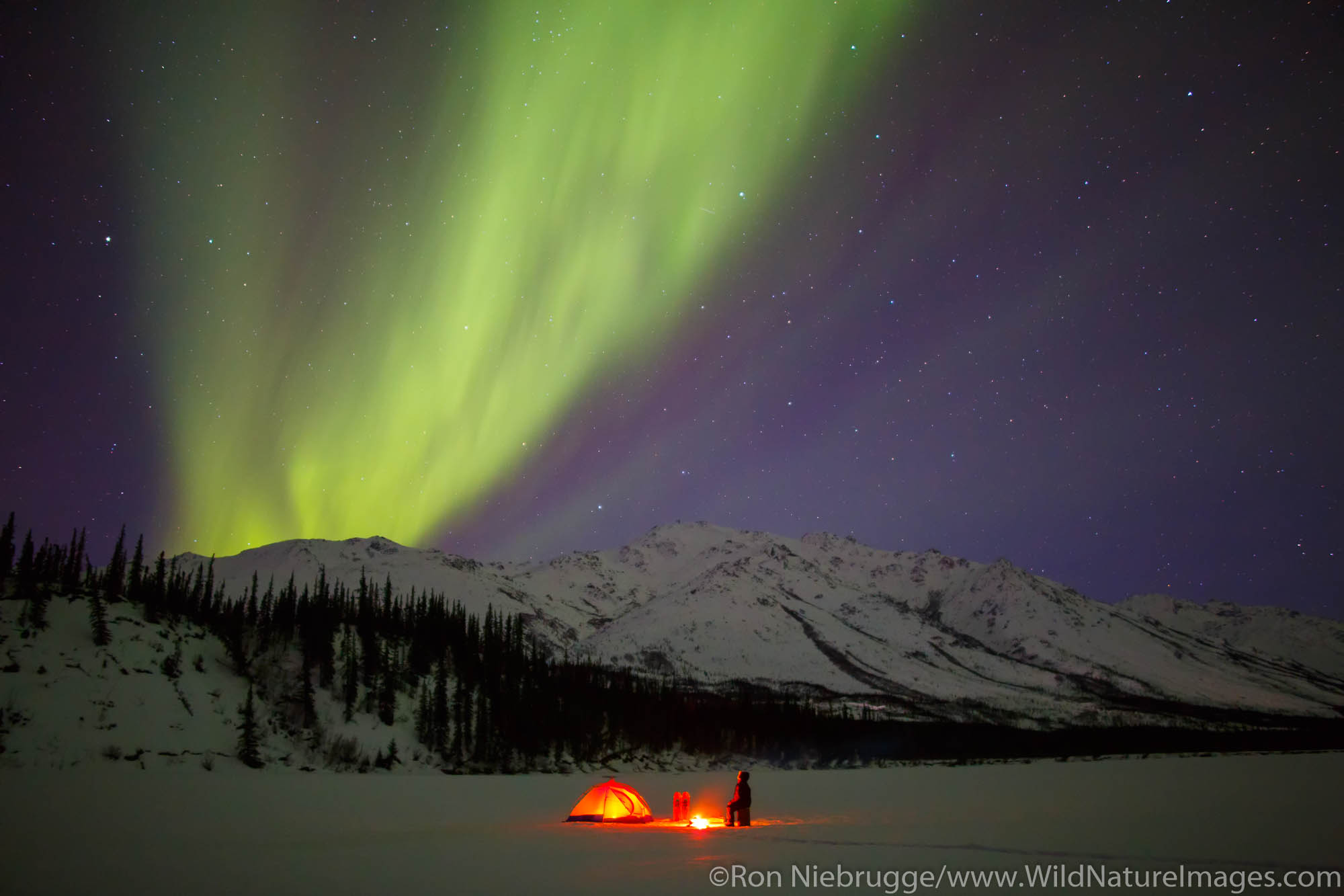 Camping under the Aurora Borealis in the Brooks Range Alaska.