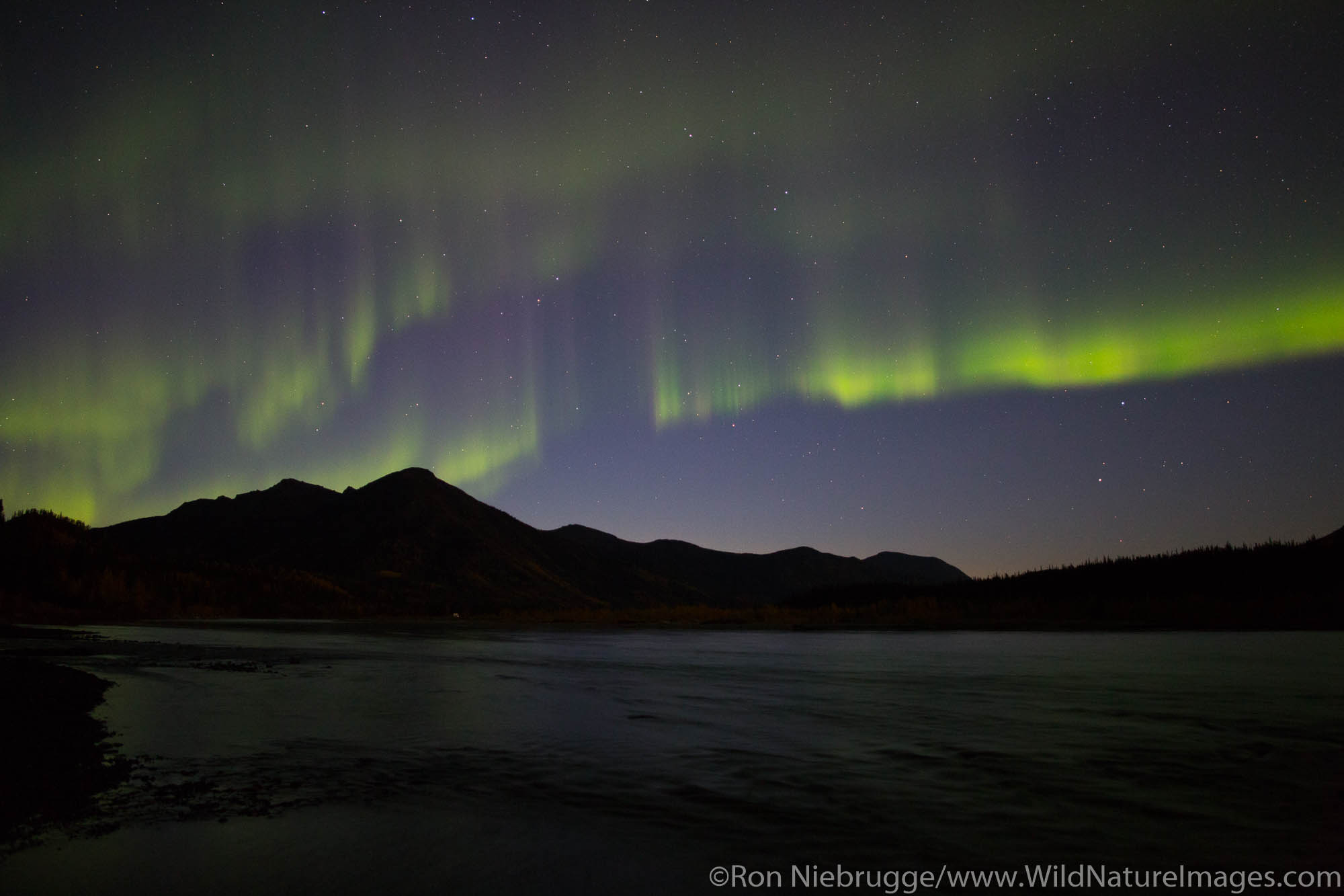 Northern Lights in the Brooks Range from the Dalton Highway, Alaska.