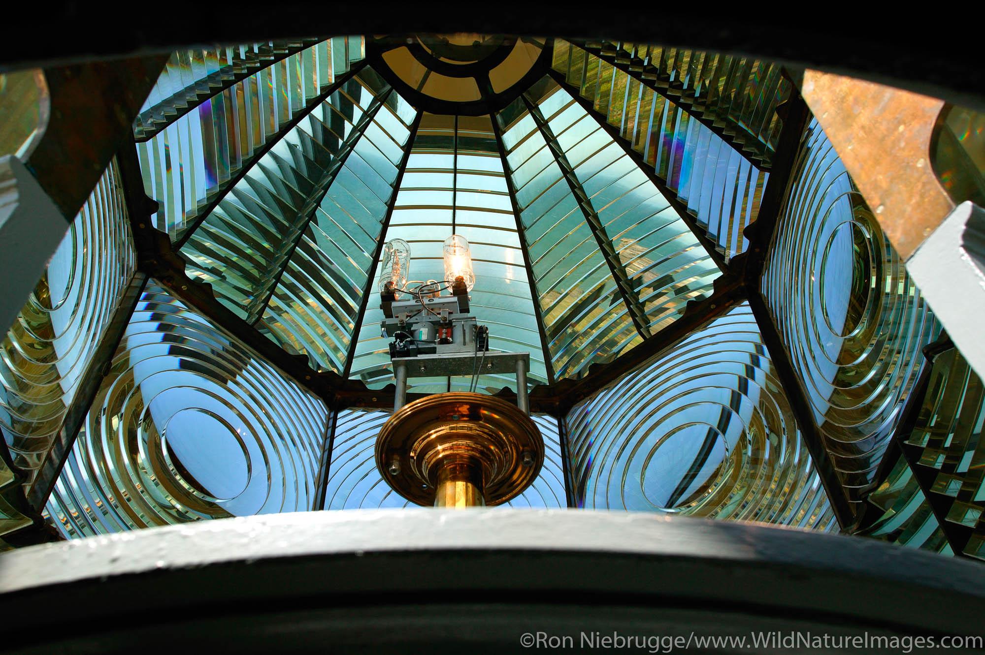 Inside the fresnel lens of the Heceta Head Lighthouse, Oregon.