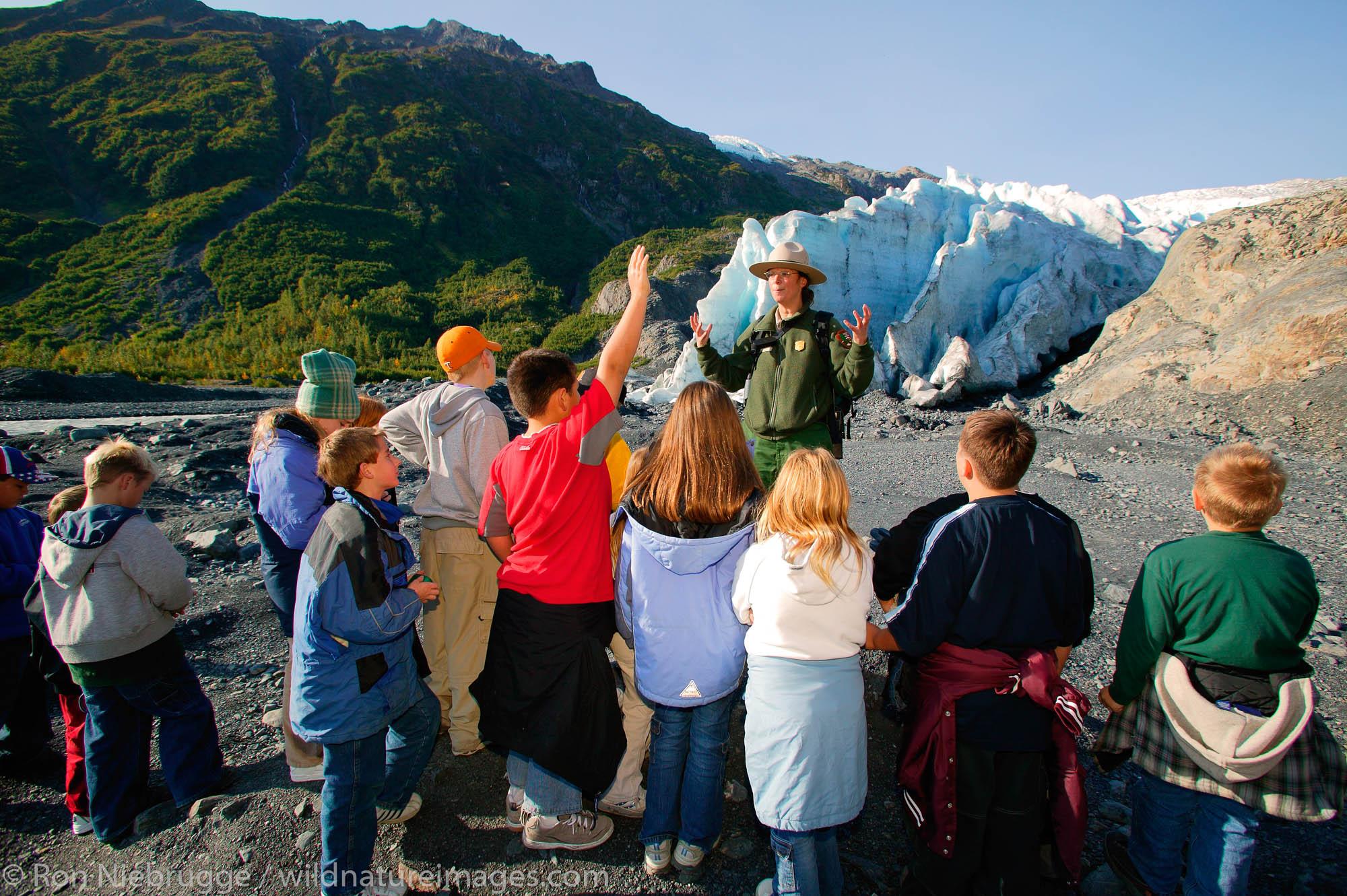 A Park Ranger leading a group of students on a field trip to Exit Glacier, Kenai Fjords National Park, near Seward, Alaska.