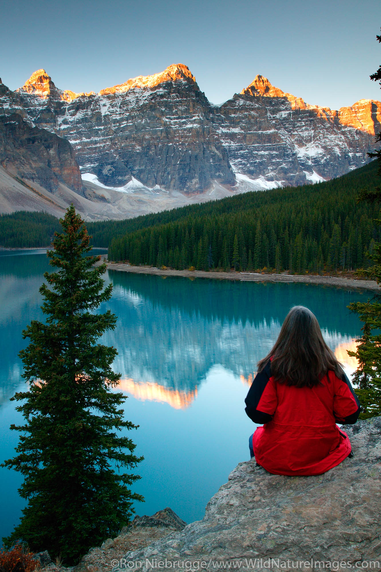 Visitor (MR) views Moraine Lake and the Valley of the Ten Peaks, Banff National Park, Alberta, Canada.  Model Released.