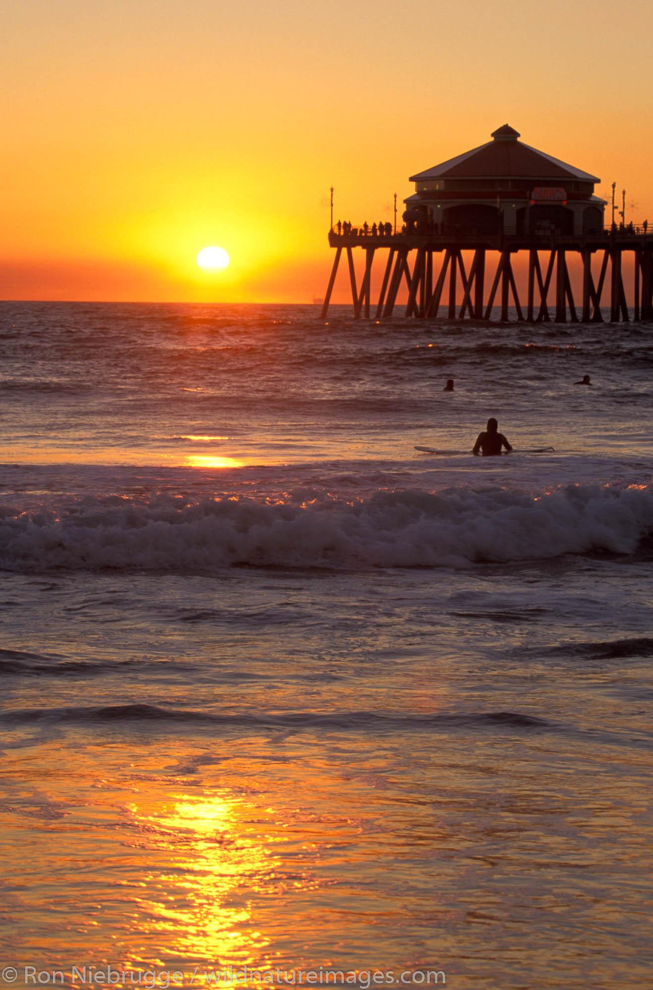 Surfing at Sunset.  Huntington Beach Pier, California.