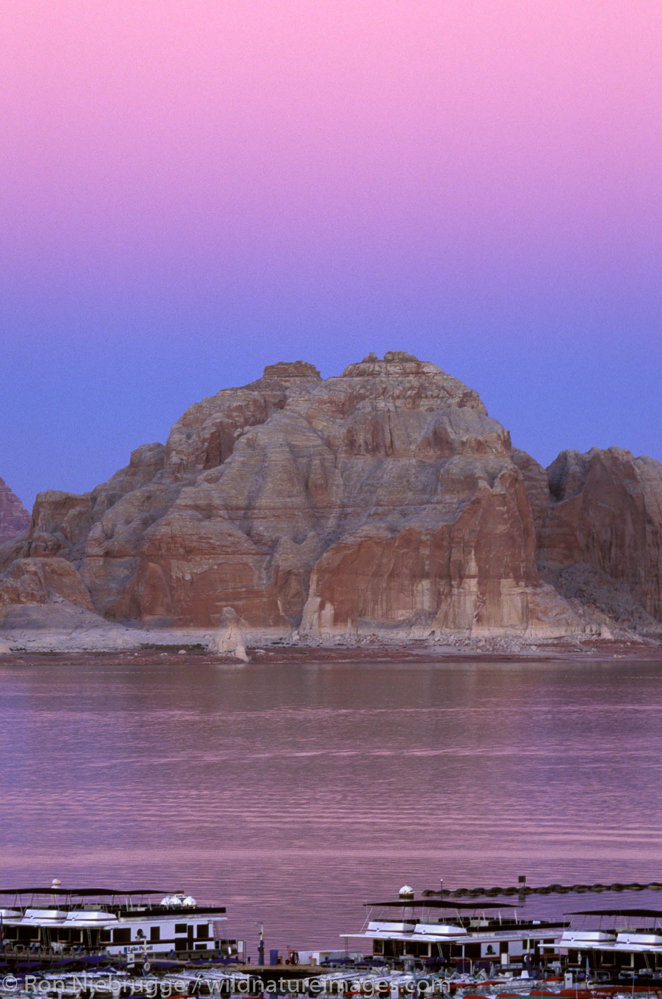 Houseboats on Lake Powell and the Glen Canyon National Recreation Area at sunrise, Page, Arizona.