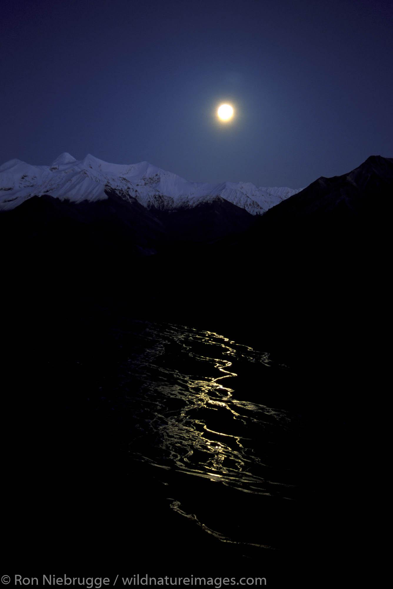 Full moon over the Alaska Range and the McKinley River, Denali National Park, Alaska.