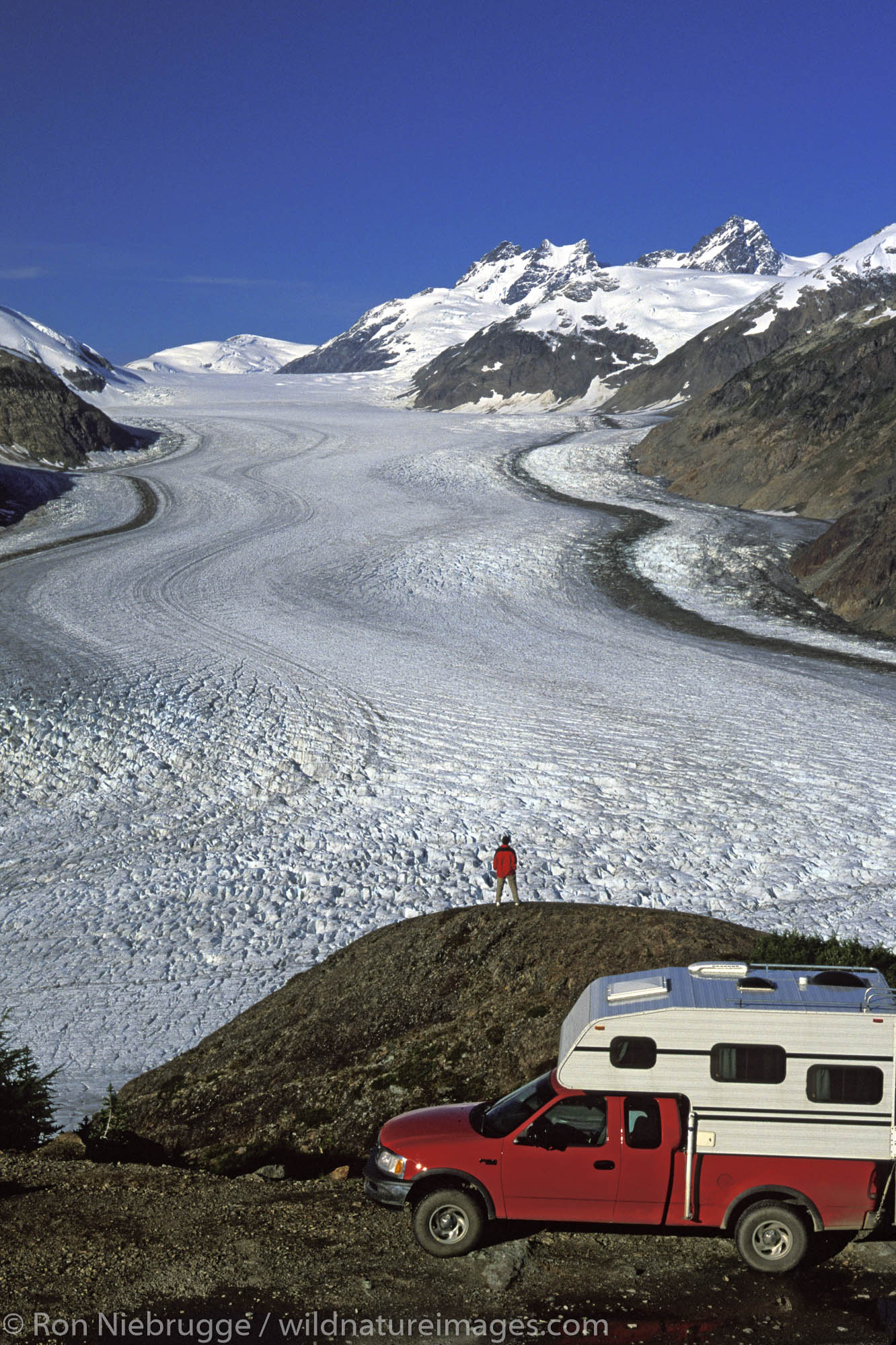 A visitor with a camper views the Salmon Glacier on the Alaska / British Columbia boarder.