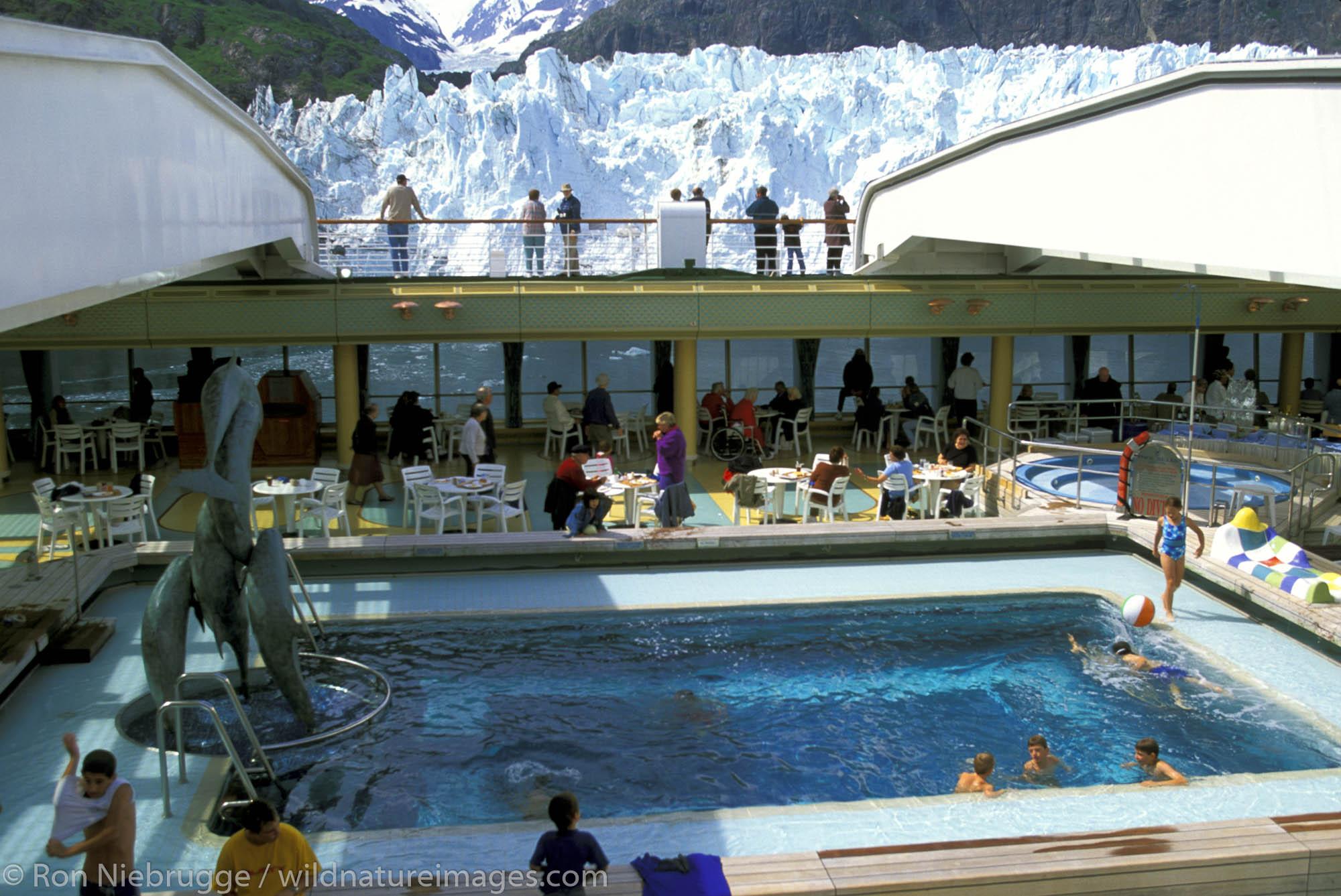 Holland-America Cruise Lines, Veendam.  Passengers gather around pool.  Margerie Glacier, Glacier Bay National Park. Alaska.